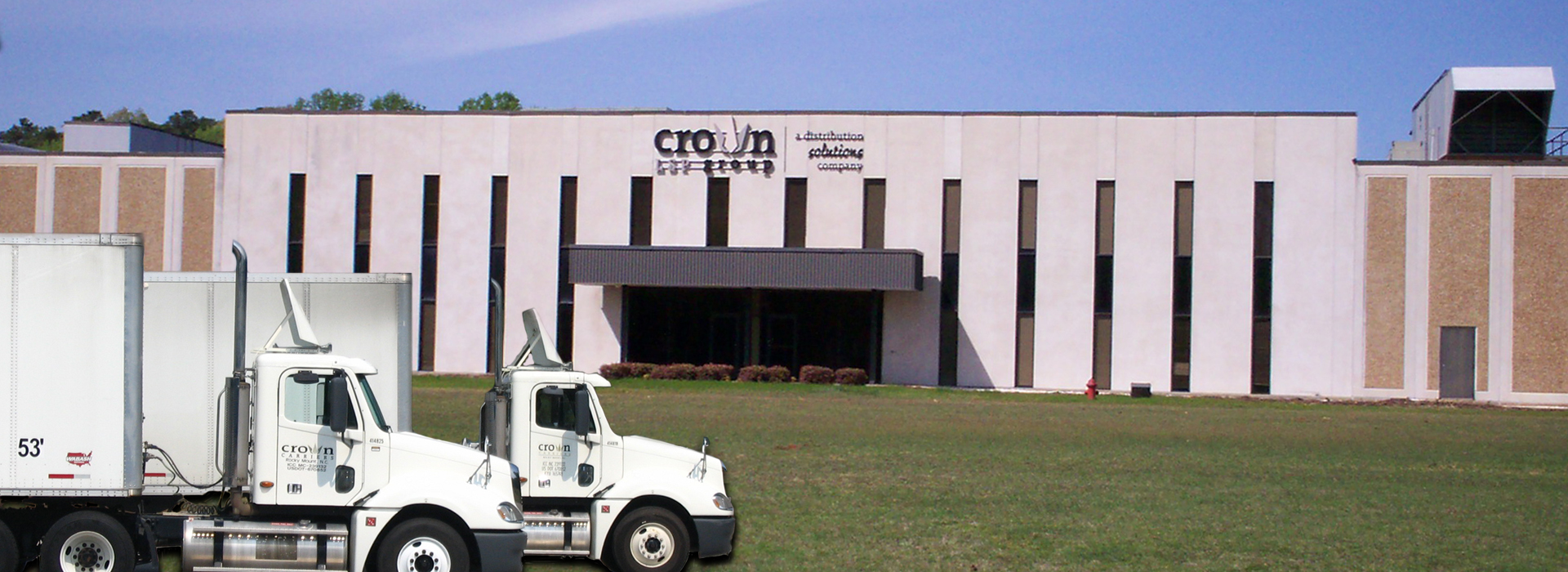 semi truck in front of Crown building