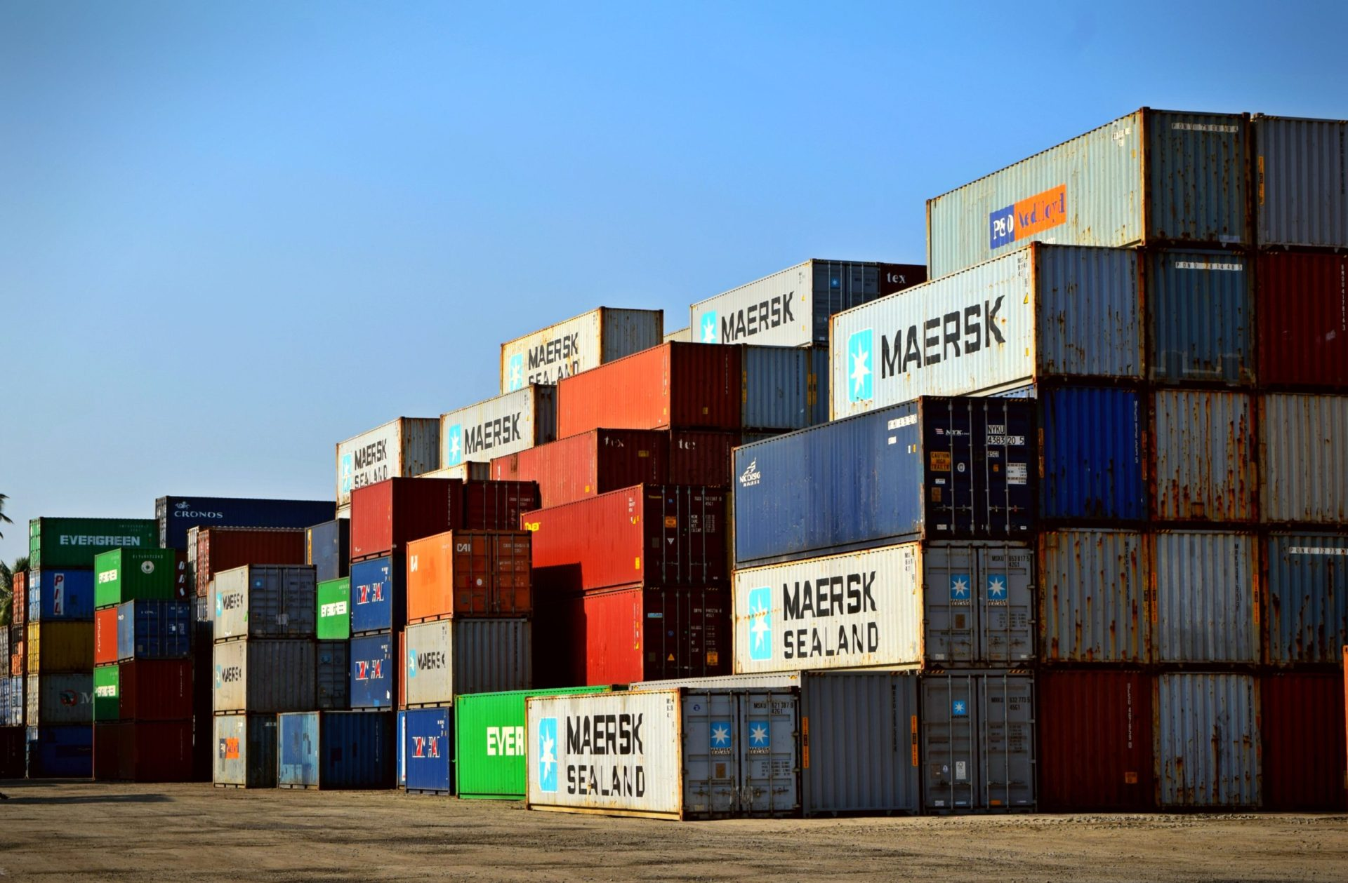 stacked freight containers in port yard