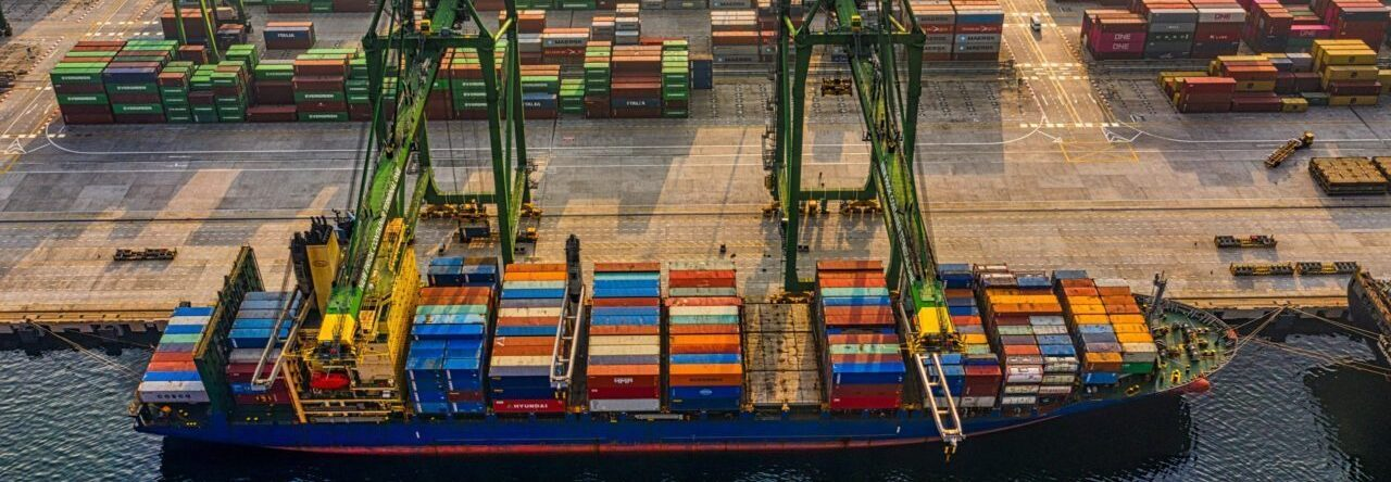 aerial view of container ship and yard at port
